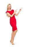 Blonde Frau im Scharlachrot Kleid lokalisiert auf Weiß Stockfotografie