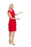 Blonde Frau im Scharlachrot Kleid lokalisiert auf Weiß Lizenzfreies Stockfoto