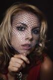 Blonde Frau im Schleier Stockfoto