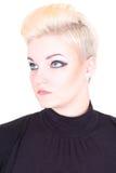 Blonde Frau im Schwarzen mit Verfassung Lizenzfreie Stockbilder