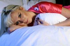 Blonde Frau im Sport Jersey Stockfotos