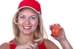 Blonde Frau mit Apfel Stockfoto