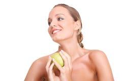 Blonde Frau mit Apfel Lizenzfreie Stockfotografie
