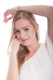 Blonde Frau mit Arm-Unkosten und Hand auf Chin Stockfotografie