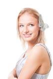 Blonde Frau mit Basisrecheneinheit in ihren Haaren Stockfoto