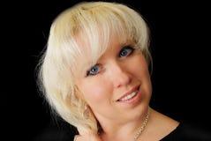 Blonde Frau mit blauen Augen. Stockbilder