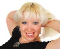 Blonde Frau mit blauen Augen. Stockfotografie