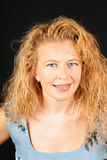 Blonde Frau mit blauen Augen Stockfotografie