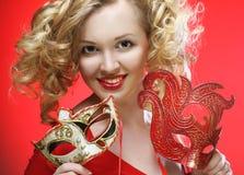 Blonde Frau mit carniv Stockfotografie