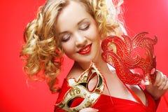 Blonde Frau mit carniv Stockbild