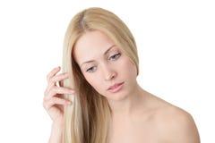 Blonde Frau mit dem langen Haar Stockfotografie