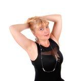 Blonde Frau mit den Händen auf Kopf Stockbilder