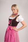 Blonde Frau mit Dirndl Stockfotografie