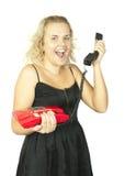 Blonde Frau mit einem roten Retro- Telefon Lizenzfreie Stockbilder
