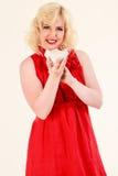 Blonde Frau mit einer Schüssel Reis Stockbilder