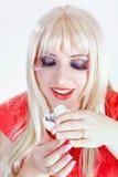 Blonde Frau mit einer starken Verfassung Stockbild