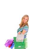 Blonde Frau mit Einkaufenbeuteln Stockbild