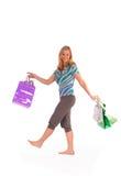 Blonde Frau mit Einkaufenbeuteln Lizenzfreies Stockbild