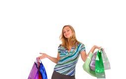 Blonde Frau mit Einkaufenbeuteln Stockbilder