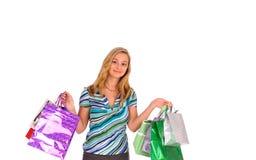 Blonde Frau mit Einkaufenbeuteln Lizenzfreie Stockfotos