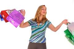 Blonde Frau mit Einkaufenbeuteln Lizenzfreie Stockbilder