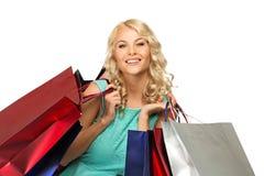 Blonde Frau mit Einkaufstaschen Lizenzfreies Stockbild