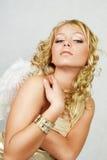 Blonde Frau mit Engelsflügeln Lizenzfreies Stockfoto