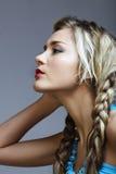 Blonde Frau mit Flechten. Stockfotos
