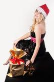 Blonde Frau mit Geschenktasche Stockbilder