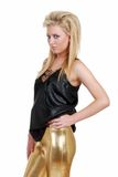 Blonde Frau mit Goldhosen Stockfotografie