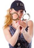 Blonde Frau mit Handschellen Stockfotos