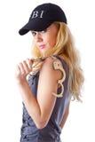 Blonde Frau mit Handschellen Stockbilder