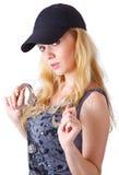Blonde Frau mit Handschellen Stockbild