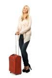 Blonde Frau mit Koffer Lizenzfreie Stockfotos