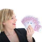 Blonde Frau mit Lots Bargeld Stockfoto