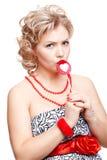 Blonde Frau mit Lutscher Stockbilder