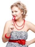 Blonde Frau mit Lutscher Lizenzfreie Stockfotos