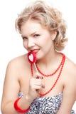 Blonde Frau mit Lutscher Stockbild