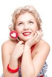 Blonde Frau mit Lutscher Stockfotografie