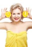 Blonde Frau mit Orange Stockfotos