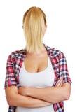 Blonde Frau mit Pferdeschwanz vor Gesicht Stockfotografie