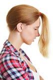 Blonde Frau mit Pferdeschwanz zur Front Stockfotografie