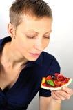 Blonde Frau mit Pizza Stockbilder