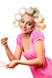 Blonde Frau mit Rollen Stockfoto