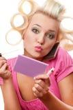 Blonde Frau mit Rollen Lizenzfreies Stockfoto