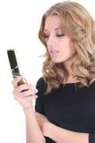 Blonde Frau mit Telefon Lizenzfreie Stockfotos