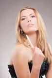 Blonde Frau mit Verfassungssteuerknüppel Stockfotos