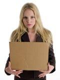 Blonde Frau mit Zeichen Lizenzfreie Stockfotografie