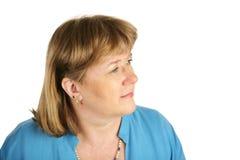 Blonde Frau stellt Zukunft gegenüber Stockfotografie