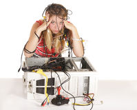 Blonde Frau verlor in der Technologie Stockfotografie